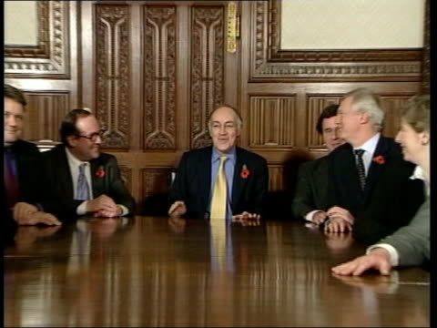 Michael Howard's shadow cabinet POOL David Willetts MP Shadow Secretary of State for Work Pensions sitting with Lord Saatchi CMS Michael Howard MP...