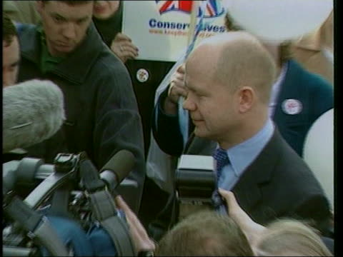conservative party race row lib pudsey william hague mp surrounded by press pull out - will.i.am stock videos & royalty-free footage