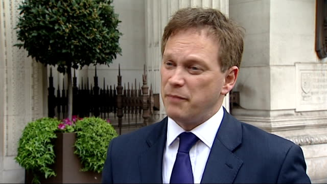 david cameron speech cutaways ext people leaving building / grant shapps mp setup shot speaking to press and interview sot - grant shapps stock videos and b-roll footage