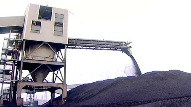 conservatives oppose green energy levies date / location coal falling onto heap coal along conveyor belt and falling into heap power station with... - didcot stock videos and b-roll footage