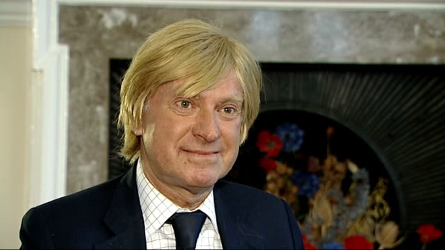 conservatives rule out ukip pact over europe london int setup shots of michael fabricant mp at home with reporter michael fabricant mp interview sot... - 英国独立党点の映像素材/bロール
