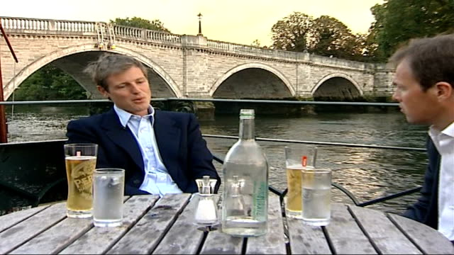conservatives unveil green plans goldsmith and reporter sat at table outside restaurant zac goldsmith interview sot geese preening at side of lake... - preening animal behavior stock videos & royalty-free footage