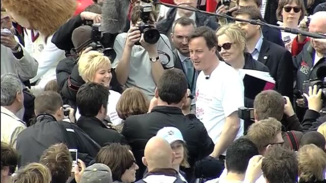 conservatve party leader david cameron chats to female participant at charity walk during in election campaign uk; 12 april 2010 - participant stock videos & royalty-free footage