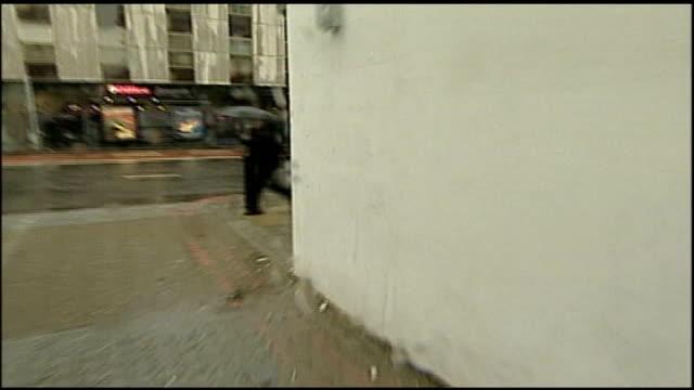 london michael portillo mp walks towards holding umbrella more ditto bv portillo walking along crosses road - michael portillo stock videos & royalty-free footage