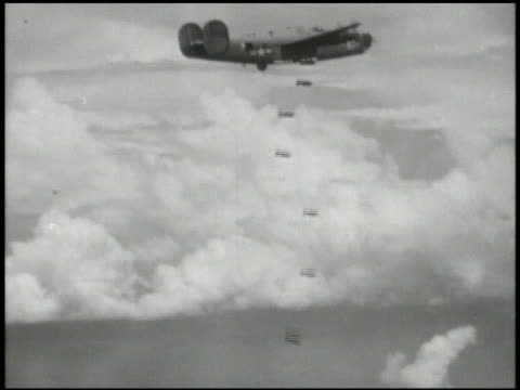 consolidated b24 'liberator' four engine heavy bombers in flight aerial beside b24 dropping bombs td bombs falling toward land td ws exploding bombs... - us airforce stock videos & royalty-free footage
