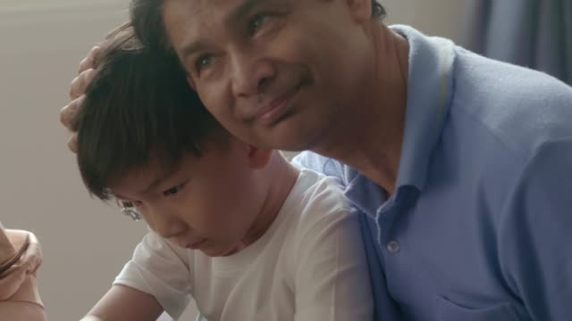 consoling little boy - frustration asian failure stock videos & royalty-free footage