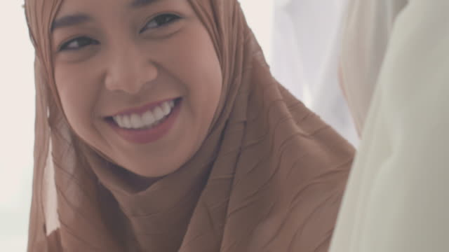 consoling - hijab stock videos and b-roll footage