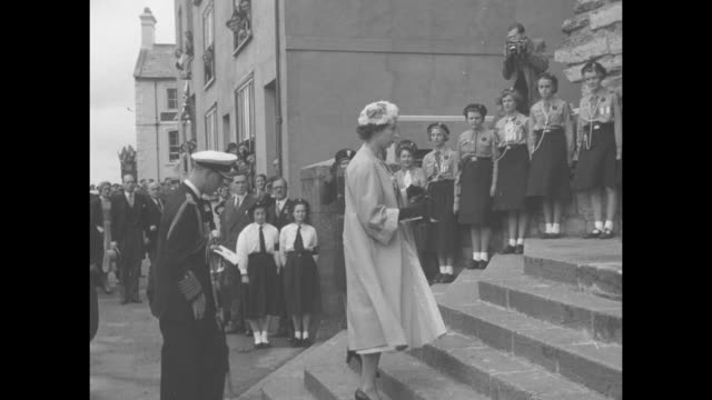 Constable of Caernarfon Castle William OrmsbyGore presents key to the Castle to Queen Elizabeth II as they stand on steps of Castle Prince Philip...