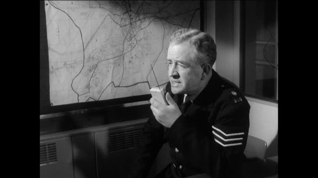 vídeos de stock, filmes e b-roll de montage a constable on a police radio giving instructions to beat officers and then leaving the station / chester, england, united kingdom - força policial