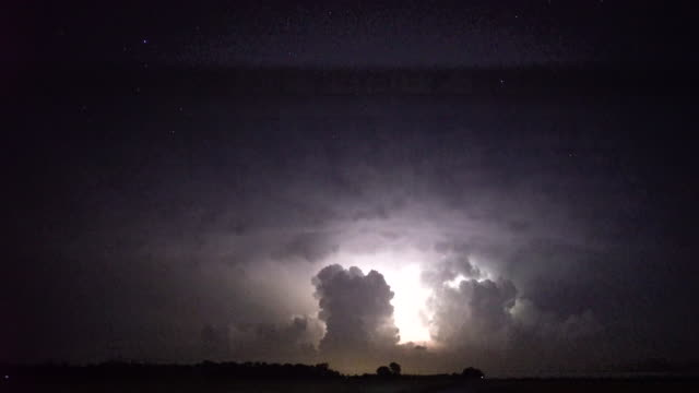 constant lightning flashes and lightning bolts shoot out of a cluster of tornado producing supercell thunderstorms near salina ks brilliant stars can... - temporale video stock e b–roll