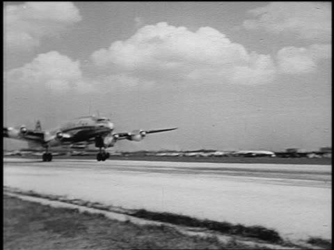 b/w 1951 pan twa constellation airliner taking off on runway / midway airport, chicago - yorkville illinois stock videos & royalty-free footage