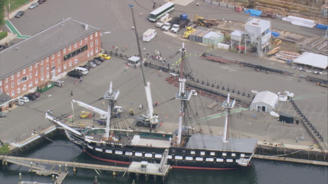 aerial uss constitution ship anchored in port at boston harbor in downtown area / massachusetts, united states - uss constitution stock videos and b-roll footage