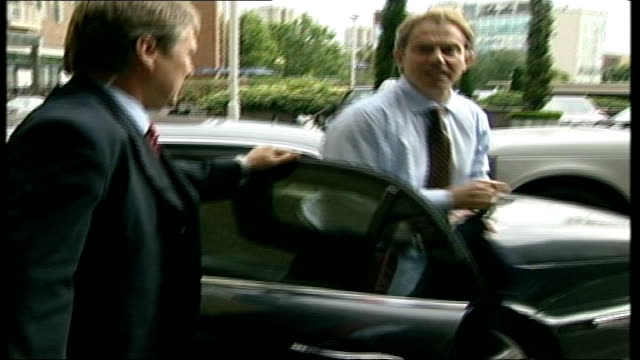 tony blair backs signing; itn england: london: bbc: ext tony blair mp out of car on arrival for interview - personal land vehicle stock videos & royalty-free footage