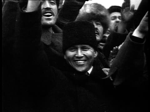 stockvideo's en b-roll-footage met constitution voted, festivities for new constitution in red square, voroshilov and molotov on mausoleum, kaganovich, ordzhonikidze, demonstrators... - 1936
