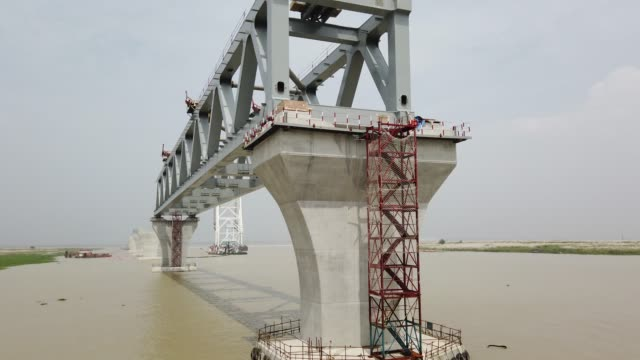 constructing padma bridge seen at the jajira point in shariatpur, bangladesh on october 01, 2019. the padma bridge will connect the south-west of the... - bridge built structure stock videos & royalty-free footage