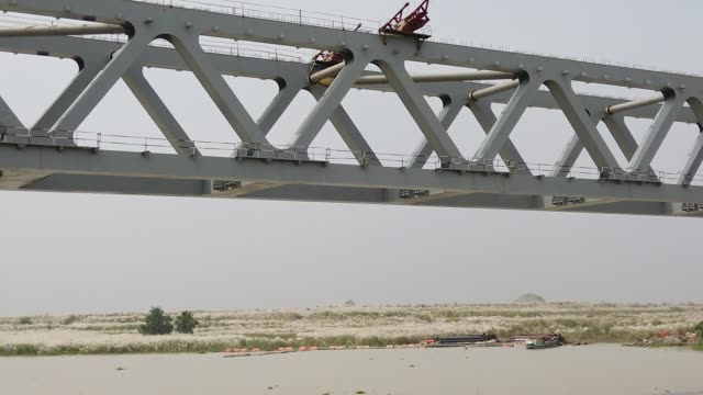 constructing padma bridge seen at the jajira point in shariatpur bangladesh on october 01 2019 the padma bridge will connect the southwest of the... - bridge built structure stock videos & royalty-free footage
