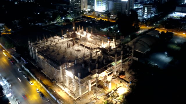 Construction: 4k Time-lapse: Aerial view of working Construction site