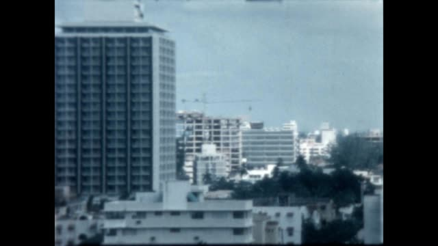 Construction and development in San Juan in the early 1960's from a home movie archive / Nice shot of a rainbow at the end