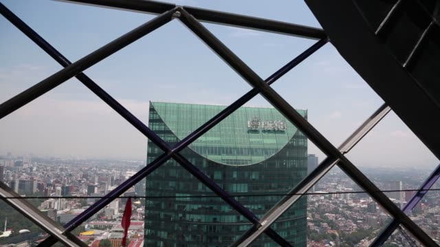 construction at the bbva bancomers mexico headquarters building in mexico city mexico on thursday july 17 the ixe bank logo sits atop the torre mayor... - mayor stock videos & royalty-free footage