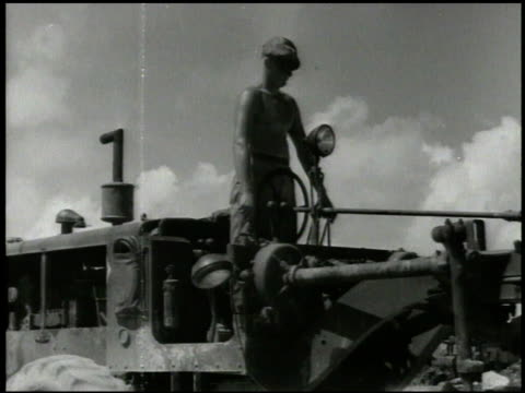 s construction battalion operating bulldozer paving ground vs us pilots amp fighter aircraft taking off from aslito airfield world war ii wwii... - mariana islands stock videos and b-roll footage