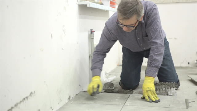 Construction. Construction work with ceramic floor tiles.