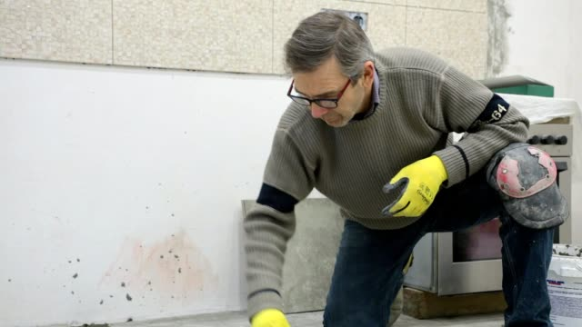 construction. construction work with ceramic floor tiles. - ukrainian ethnicity stock videos and b-roll footage