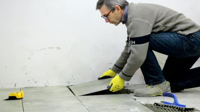 construction. construction work with ceramic floor tiles. - tile stock videos & royalty-free footage
