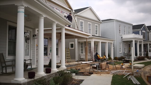 construction contractors work on a house under construction in the norton commons subdivision of louisville kentucky us on wednesday march 7 2018 - kentucky stock videos & royalty-free footage