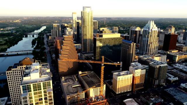 construction crane at sunrise in downtown austin , texas , usa - austin texas stock videos & royalty-free footage