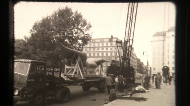 construction crane lifting a large eagle statue to top of american embassy, london, uk - eagle stock videos & royalty-free footage