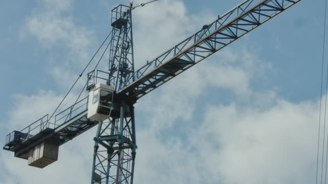 construction crane on a blue sky. close up - high up stock videos & royalty-free footage