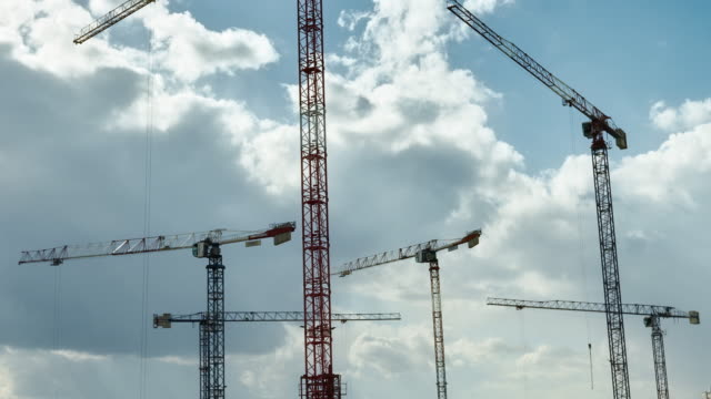 construction crane on a blue sky. cloudscape - high up stock videos & royalty-free footage