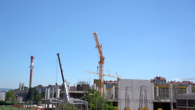construction crane transporting heavy material - picking up stock videos & royalty-free footage