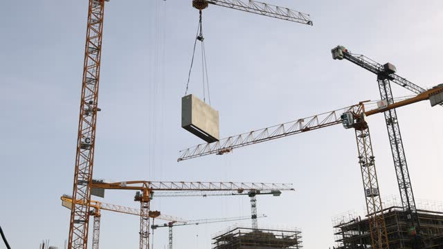 construction crane transports a concrete part at a residential building under construction in the city center on february 23, 2021 in berlin,... - コンクリート点の映像素材/bロール