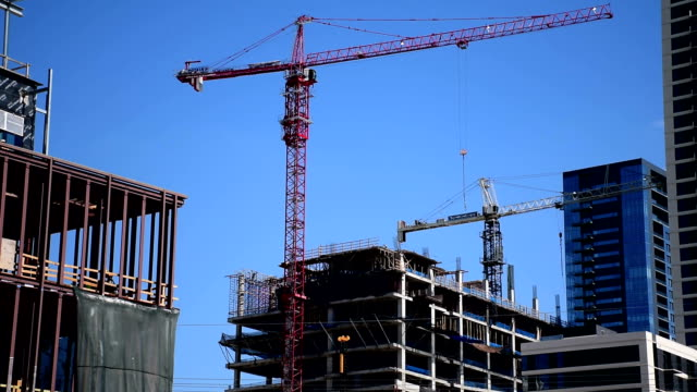 Construction Cranes moving and building the new Austin Texas Downtown Skyline Highrise and Condominium 2016 Urban City life