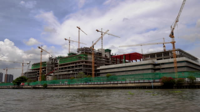 Construction cranes, Riverside Promenade, Chao Phraya river, Bangkok, Thailand, Asia