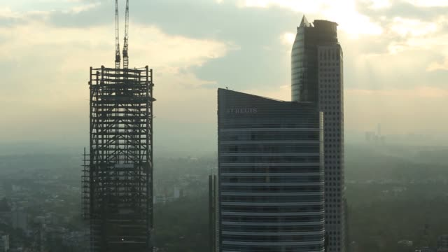 construction cranes sit in top of the bbva bancomer headquarters building in mexico city mexico construction cranes sit on top of the bbva bancomer... - mayor stock videos & royalty-free footage