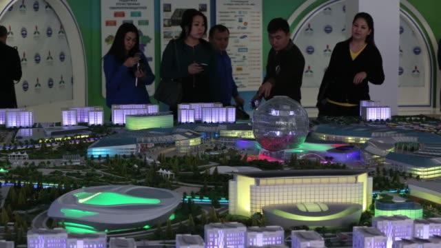 Construction cranes stand beside the Astana Expo 2017 Sphere in Astana Kazakhstan on Wednesday Nov 23 2016