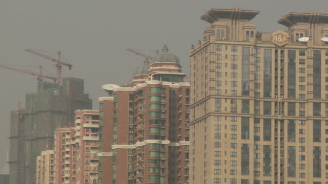 Construction cranes with residential buildings in Guangzhou China