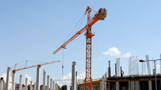 construction cranes work at construction site - high up stock videos & royalty-free footage