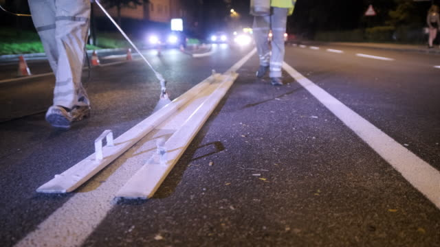 construction crew spray painting crosswalk stripes at night - freshly painted stock videos & royalty-free footage