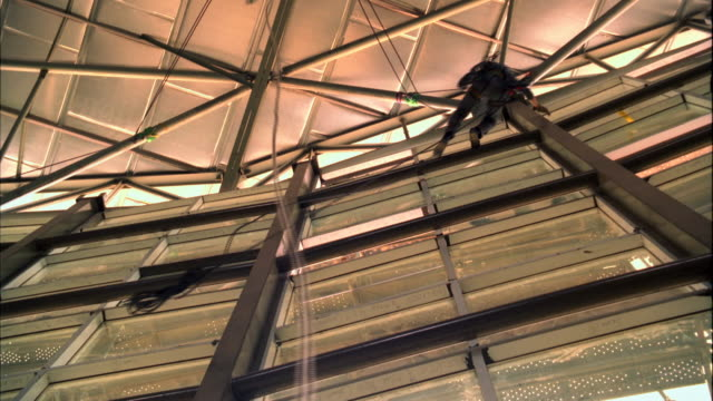 construction crew using on ropes and safety harnesses work at height - safety harness stock videos & royalty-free footage