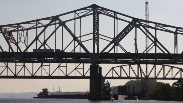 Construction crews work to erect a new Interstate 65 highway bridge across the Ohio River in downtown Louisville Kentucky Traffic moves through the...