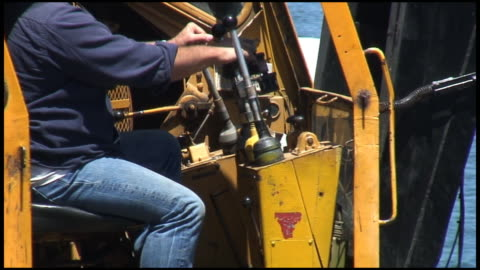 hd: construction digger, crane operator at work - crane construction machinery stock videos & royalty-free footage