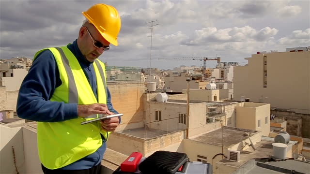 construction engineer on construction site using digital tablet