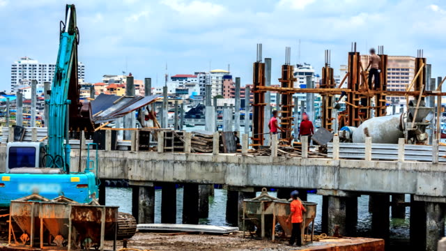 construction laborers working hard building timelapse - bridge built structure stock videos & royalty-free footage