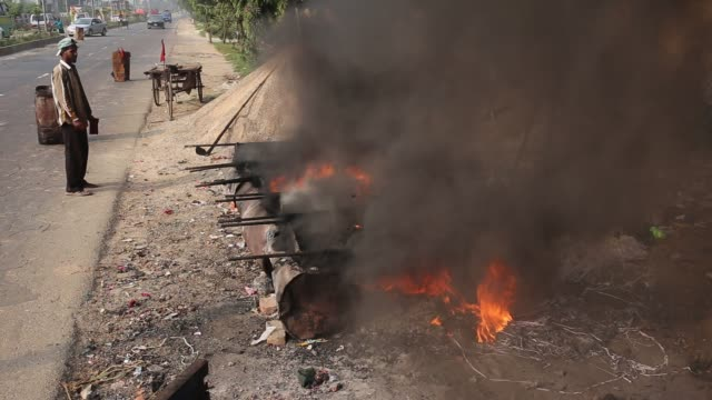 construction labors work amid smoke emitting from heating construction materials to repair roads in the outskirts of savar bangladeshon november 17... - emitting stock videos & royalty-free footage