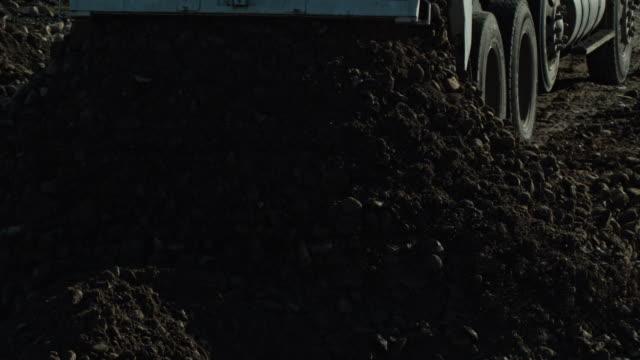 construction machines dump truck dirt load - bulldozer stock videos & royalty-free footage