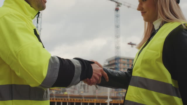 construction management workers. handshake. - architectural model stock videos & royalty-free footage