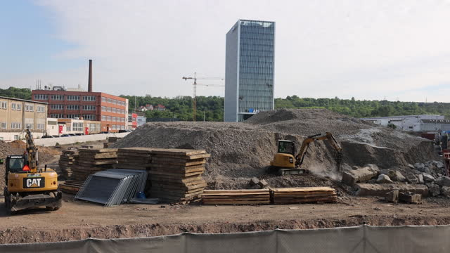construction materials and machinery at construction site in prague, czech republic, on friday, june 4, 2021. - crane construction machinery stock videos & royalty-free footage